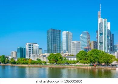 FRANKFURT, GERMANY, AUGUST 18, 2018: Skyscrapers alongside river Main in Frankfurt, Germany