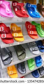Frankfurt, Germany - August 2018: Birkenstock sandals in a variety of vibrant colors on display rack.