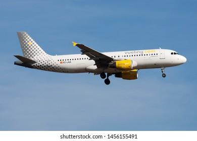 FRANKFURT / GERMANY - AUGUST 21, 2013: Vueling Airbus A320 EC-LAA passenger plane landing at Frankfurt Airport