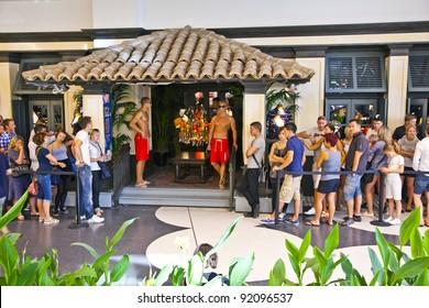 FRANKFURT, GERMANY - AUGUST 21: people queue to enter Hollister shop on August, 21,2010 in Frankfurt, Germany. Hollister opened this first shop in Germany on April 5, 2010.