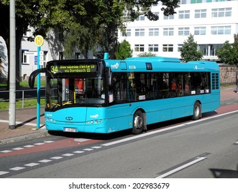 Frankfurt, Germany - August 28, 2011: Public bus in Frankfurt at a bus stop. People are already in the bus ready for departure.