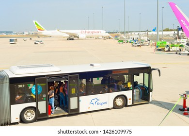 FRANKFURT, GERMANY - AUGUST 29, 2019: Bus with passengers at Frankfurt airport. The airport has a capacity of approximately 65 million passengers per year