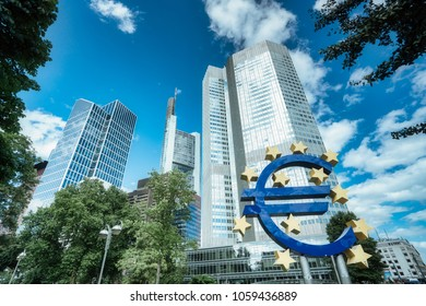 Frankfurt, Germany - August 3, 2017: Large sign for the Euro in front of the European Central Bank headquarters (Eurotower) in Frankfurt am Main on a clear day.