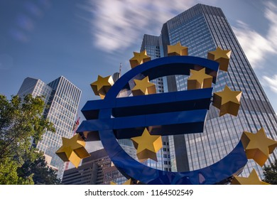 FRANKFURT, GERMANY - AUGUST 9, 2018: Euro Sign in front of the Commerzbank Tower Financial district in Frankfurt.