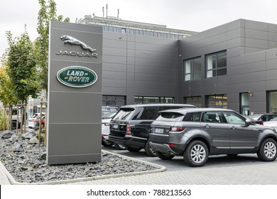 Frankfurt, Germany - CIRCA, 2017: Jaguar, Land Rover automobile dealership sign in front of the showroom. Land Rover is a British multinational car manufacturer headquartered in Coventry England.