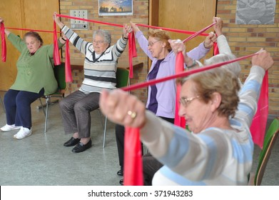Frankfurt, Germany - December 1, 2009 - Older people doing gymnastics for physical and mental health