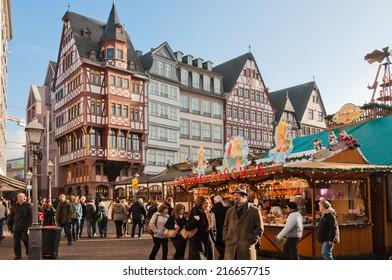 FRANKFURT, GERMANY - DECEMBER 1: People explore Frankfurt Christmas Market at Romerberg on December 1 2013. Frankfurt's Christmas Market is one of the biggest Christmas market in Germany.
