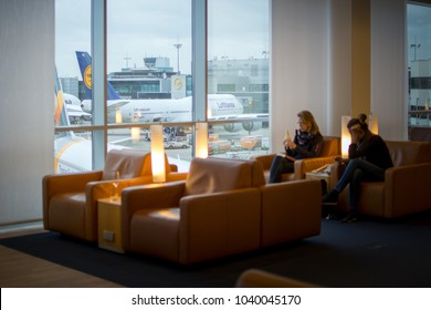 FRANKFURT, GERMANY - December 27, 2017 : Two passengers waiting for the flight with Boeing 747-8 of Lufthansa as background.