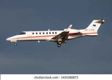 FRANKFURT / GERMANY - DECEMBER 4, 2012: Abelag Aviation Learjet 45 OO-LFS private business jet landing at Frankfurt Airport
