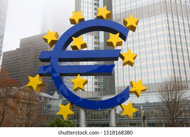 FRANKFURT, GERMANY - DECEMBER 6, 2016: Euro currency sign in front of European Central Bank in downtown Frankfurt, Germany. ECB administers monetary policy of the eurozone.