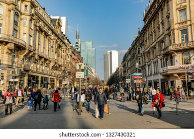 Frankfurt, Germany - FEB 28, 2019:  Looking down Kaiserstrasse from Frankfurt train station with people crossing the street.