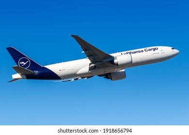 Frankfurt, Germany - February 13, 2021: Lufthansa Cargo Boeing 777-F airplane at Frankfurt Airport (FRA) in Germany. Boeing is an American aircraft manufacturer headquartered in Chicago.