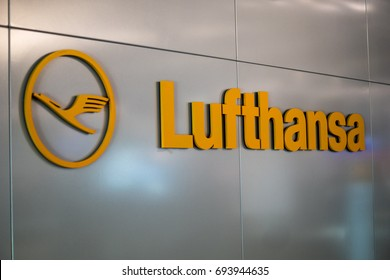 Frankfurt, Germany - February 2016: A big yellow Lufthansa logo on the wall of Frankfurt Airport, Germany. Deutsche Lufthansa AG, commonly known as Lufthansa is a major German airline.