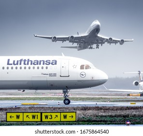 Frankfurt, Germany - February 25, 2020: Lufthansa Airbus A321 and Boeing 747 airplane at Frankfurt Int'l airport (FRA) in Germany. Airbus is an aircraft manufacturer based in Toulouse, France.