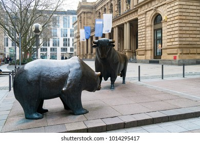 Frankfurt, Germany - January 27, 2018: Bull and bear sculpture in front of historic Frankfurt Stock Exchange building.