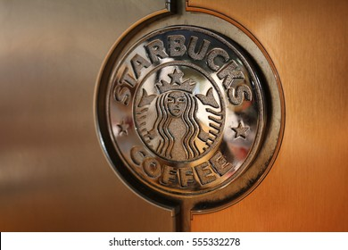 FRANKFURT, GERMANY - JUL. 19, 2016: Detail of a chrome plated Starbucks logo at coffee shop
