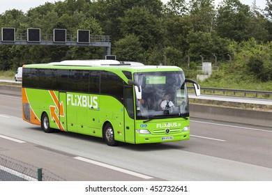 FRANKFURT, GERMANY - JULY 12, 2016: Green Flixbus european long distance coach on the highway in Germany
