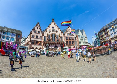 FRANKFURT, GERMANY - JULY 19, 2014: Christopher Street Day in Frankfurt, Germany. Crowd of people participate in the parade celebrates gays, lesbians and bisexuals.  Parade starts at Roemer place.
