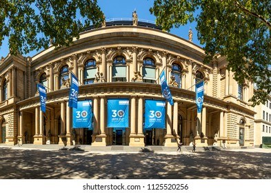 FRANKFURT, GERMANY - JULY 2, 2018. facade of stock exchange with flags to celebrate 30 years of Stock exchange in Frankfurt.