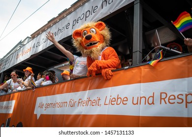 Frankfurt, Germany - July 20, 2019: People are celebrating on the ING Germany truck at the Christopher Street Day in Frankfurt.