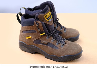 Frankfurt, Germany - July 2020: pair of ASOLO men's high trekking boots made of natural brown suede with modern GORE-TEX materials, concept special shoes for outdoor activities, sports, side view