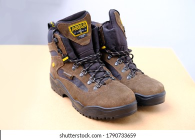 Frankfurt, Germany - July 2020: pair of ASOLO men's high trekking boots made of natural brown suede with modern GORE-TEX materials, concept special shoes for outdoor activities, sports