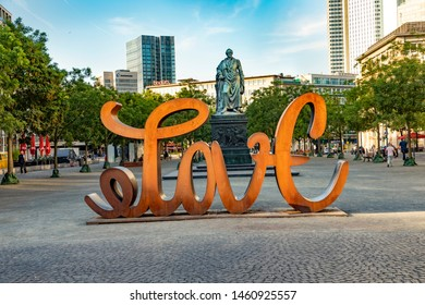 Frankfurt, Germany - July 23, 2019: view to skyline of Frankfurt with famous skyscraper built by the most important european banks and sculpture love of Mia Florentine.
