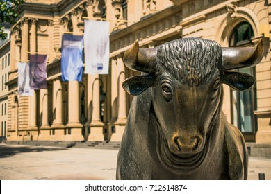Frankfurt, Germany - July 27, 2017: Bear and Bull sculpture. Frankfurt Stock Exchange building.