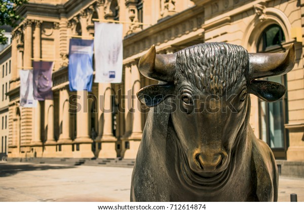 Frankfurt, Germany - July 27, 2017: Bear and Bull sculpture. Frankfurt Stock Exchange building.
