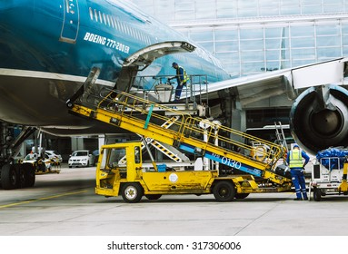 FRANKFURT, GERMANY - JULY 9, 2015: Boeing 777-200 ER is being prepared for a flight by the maintenace crew at the international airport of Frankfurt.