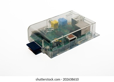 FRANKFURT, GERMANY - JUNE 16, 2014: Picture of a raspberry pi Computer in a transparent case.