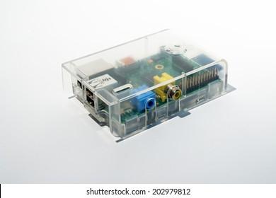 Frankfurt, Germany - June 16, 2014: Shot of a Raspberry Pi in transparent case on white.