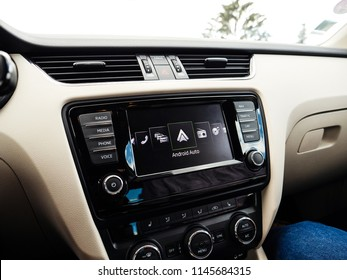 FRANKFURT, GERMANY - JUNE 22, 2018: Google Android Auto on the new luxury car dashboard digital screen display showing the icons and large text Android Auto during menu selection