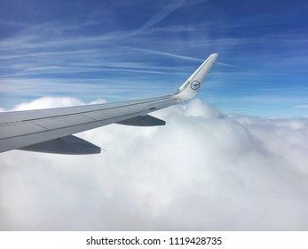 Frankfurt, Germany - June 23, 2018 : The Airbus A230 wing with Lufthansa airline logo and blue sky background.