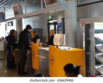 FRANKFURT, GERMANY - MAR 1, 2010 - Traveler checks in at the Lufthansa desk at the airport  in Frankfurt, Germany