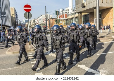 FRANKFURT, GERMANY - MAR 18, 2015: people demonstrate against EZB and Capitalism in Frankfurt, Germany. 9 tsd policemen guard the demo.