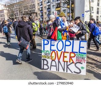 FRANKFURT, GERMANY - MAR 18, 2015: people demonstrate against EZB and Capitalism in Frankfurt, Germany. 30 tsd. people join the demo.
