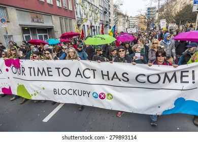 FRANKFURT, GERMANY - MAR 18, 2015: people demonstrate against EZB and Capitalism in Frankfurt, Germany. 30 tsd people demonstrate. They are holding banners.