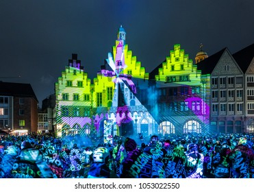 FRANKFURT, GERMANY - MAR 23, 2018: people watch the open air light spectacle Luminale in Frankfurt.  The 