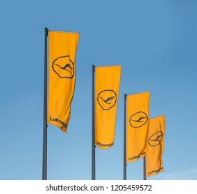 FRANKFURT, GERMANY - MARCH 20 2014: Lufthansa flag with Lufthansa symbol, the crane in Frankfurt, Germany. The aktual Lufthansa Logo is a design from 1964.