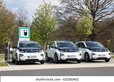 Frankfurt, Germany - March 30, 2017: Three BMW i3 electric vehicles at a charging station