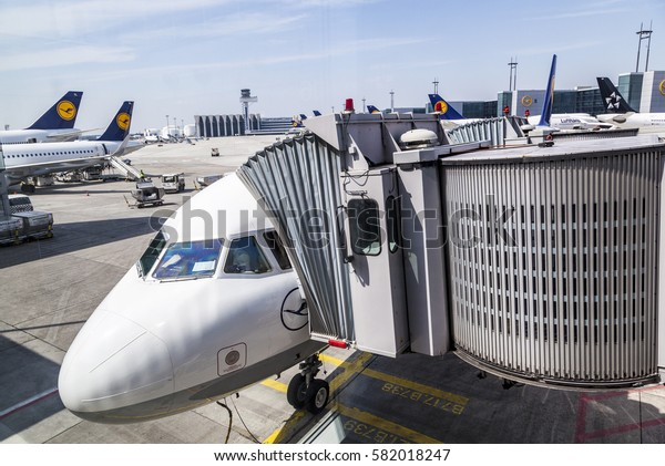 FRANKFURT, GERMANY - MAY 1, 2016: lufthansa aircraft ready for boarding at the gate at new terminal in Frankfurt.
