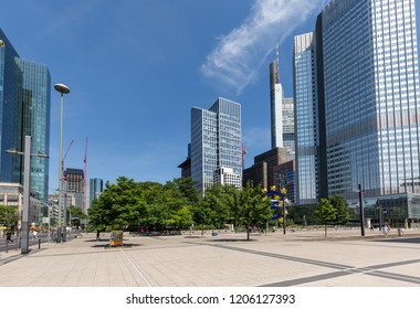 Frankfurt, Germany, May 26th. 2018 - Frankfurt, Germany, Skycrapers surrounding a park and square in front of the European Central Bank with the Euro-Sign in springtime.