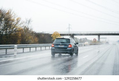 FRANKFURT, GERMANY - NOV 11, 2017: New Skoda Fabia on German autobahn on a rainy day safety confident driving under bad weather condition with speed limit sign 110 km per hour