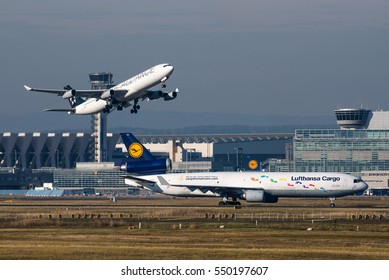 FRANKFURT / GERMANY - NOVEMBER 2016 Lufthansa Airbus A340-313, D-AIFE, cn 434 operated by Lufthansa Cityline departing from runway 25C. Lufthansa Cargo MD-11 D-ALCH is waiting to cross the runway.