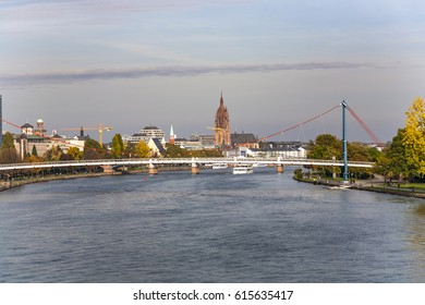 FRANKFURT, GERMANY - OCT 21, 2009: view to skyline of Frankfurt with skyscraper early morning from peace bridge.
