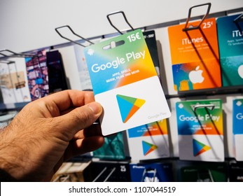 FRANKFURT, GERMANY - OCT 6, 2017: 50 Euro card in man hand point of view customer shopping for prepaid Google Play Gift card online money prepaid cards online applications computer movies music