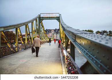 FRANKFURT, GERMANY - OCTOBER 06, 2016: Iron footbridge in Frankfurt am Main city. Iron Bridge is a pedestrian-only bridge over the Main river