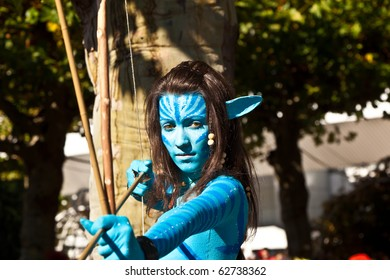 FRANKFURT, GERMANY - OCTOBER 10: Public day at Frankfurt international Book Fair, colorful girl made up as Avatar figure from the film scene and poses on October 10, 2010 in Frankfurt, Germany.
