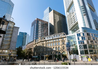Frankfurt, Germany, October 11th. 2015 - An old building is surrounded by modern skycrapers, with converging lines crushing the ancient building.
